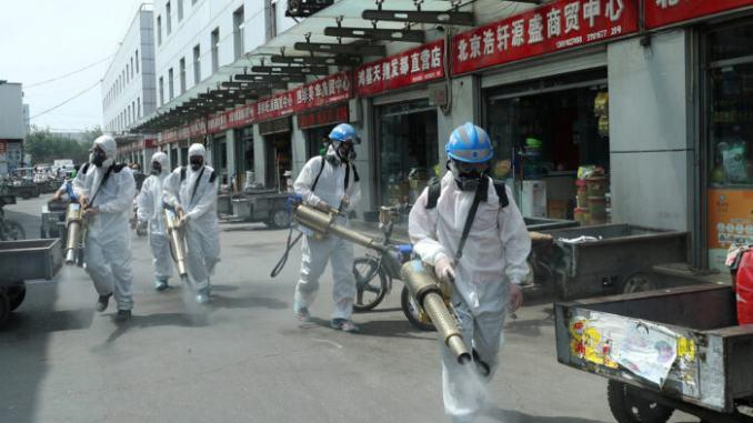 COMMENTARY: China Tries to Show It Can Fight off a New Outbreak
